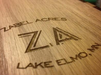 Logo detail, oak plywood